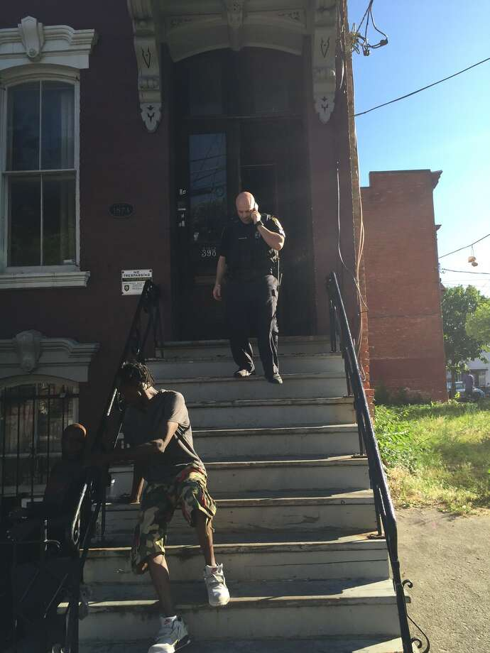 Police respond to 398 Clinton Ave. in Albany after a report of shots fired. (Amanda Fries / Times Union)