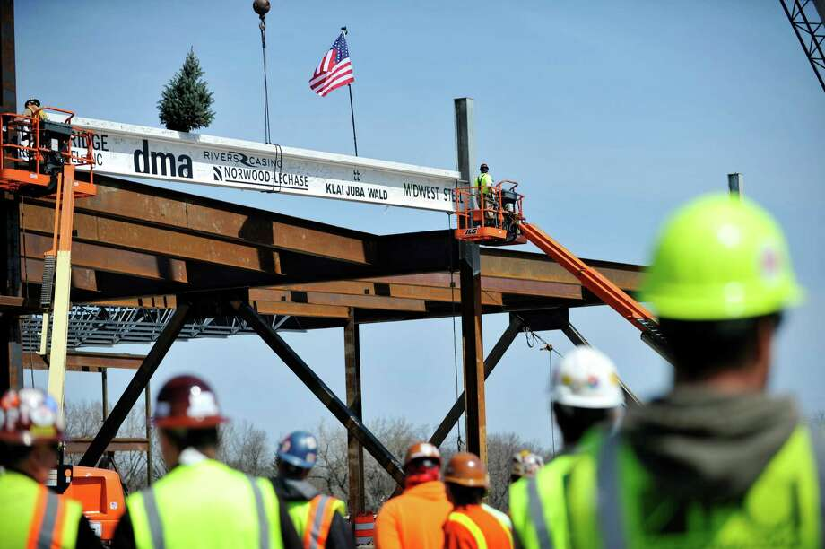 Workers with Midwest Steel out of Ballston Spa, install the final 60-foot steel beam at the Rivers Casino & Resort on Monday, April 18, 2016, in Schenectady, N.Y.  (Paul Buckowski / Times Union archive) Photo: PAUL BUCKOWSKI / 10036219A