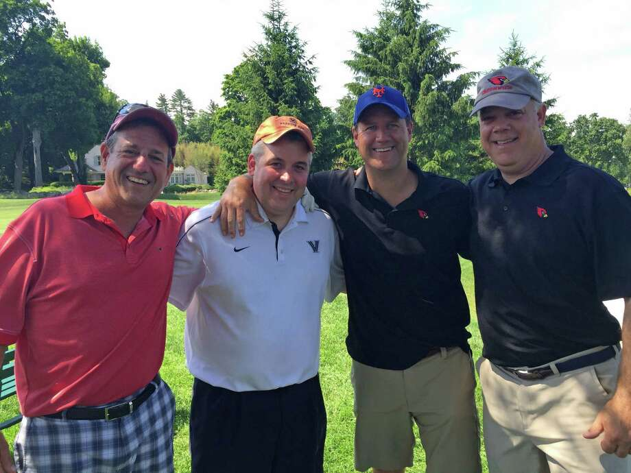 From left, program supporters Adam Cohen, Frank Ingarra and captains dads Dan Kraninger and Barry Williams particpate in the 16th annual Cardinal Quarterback Club Fundraising Golf Outing Monday at Greenwich Country Club. Photo: Contributed / Contributed Photo / Greenwich Time Contributed