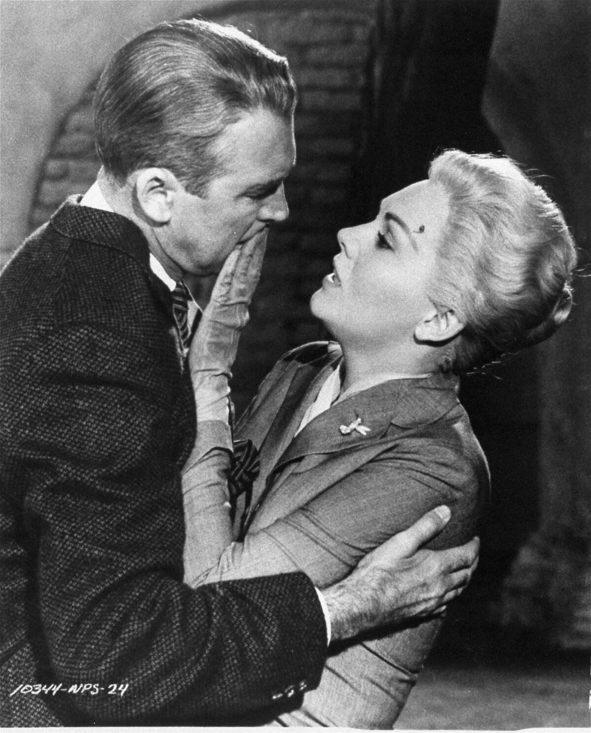 """This undated film image released by Paramount shows Jimmy Stewart, left, and Kim Novak in a scene from Alfred Hitchcock's 1958, """"Vertigo."""" Hitchcock's """"Vertigo"""" took the top spot in the top 10 greatest movies ever list conducted by Sight & Sound, ending the 50-year-long run for Welles' """"Citizen Kane."""" The magazine, published by the British Film Institute, surveys international film critics every decade. (AP Photo/Paramount Pictures, file)"""