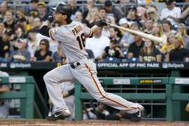 San Francisco Giants' Angel Pagan watches his grand slam off Pittsburgh Pirates pitcher Wilfredo Boscan during the fourth inning of a baseball game Tuesday, June 21, 2016, in Pittsburgh. (AP Photo/Keith Srakocic)