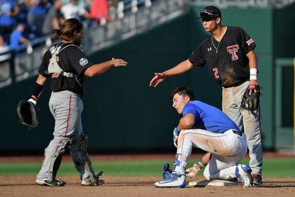 Unlike Texas Tech's Tyler Floyd, left, and Orlando Garcia, Florida will have a tough time shaking off the game after Jonathan India was thrown out at second.