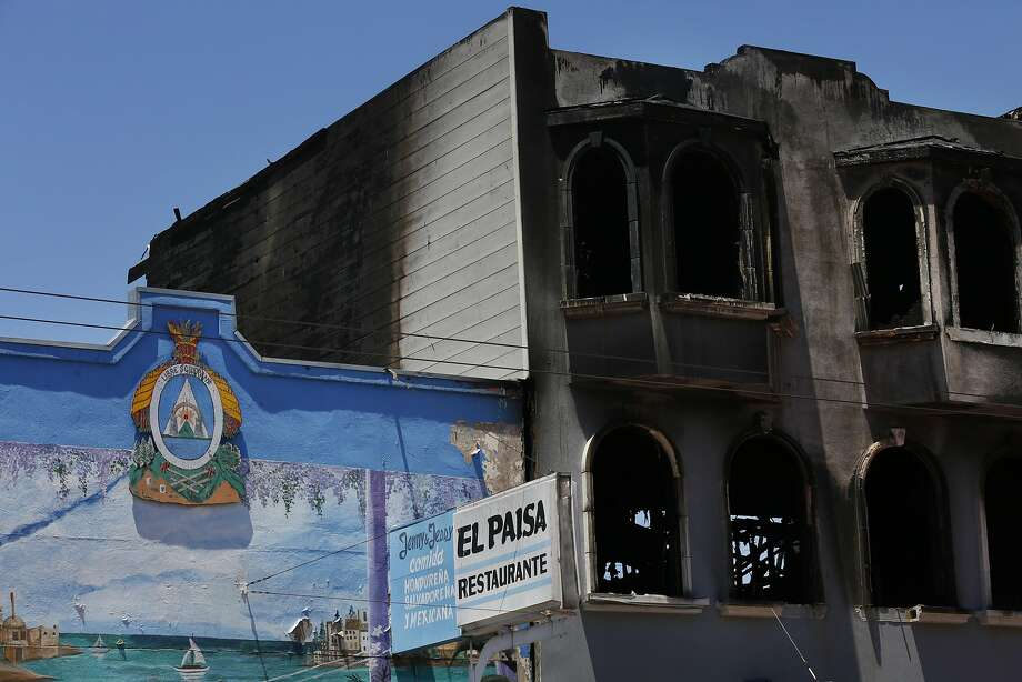 The remains of a building that was destroyed in a five-alarm fire over the weekend can be seen on Mission Street June 21, 2016 in San Francisco, Calif. Photo: Leah Millis, The Chronicle