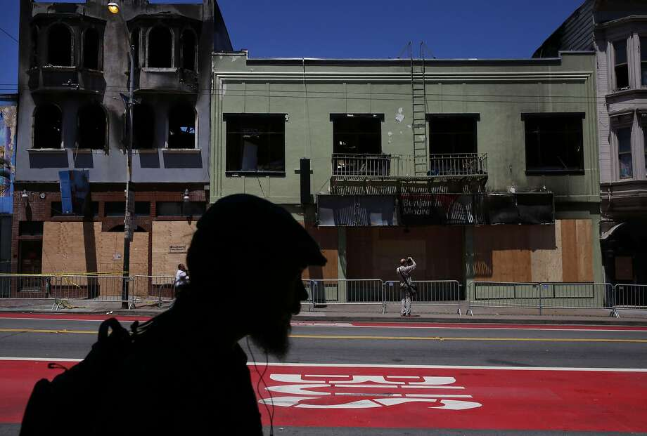 Businesses are seen boarded up in the 3300 block of Mission Street after they were damaged in a five-alarm fire Saturday that displaced 58 residents and nine businesses, striking at the core of a vibrant neighborhood. Photo: Leah Millis, The Chronicle