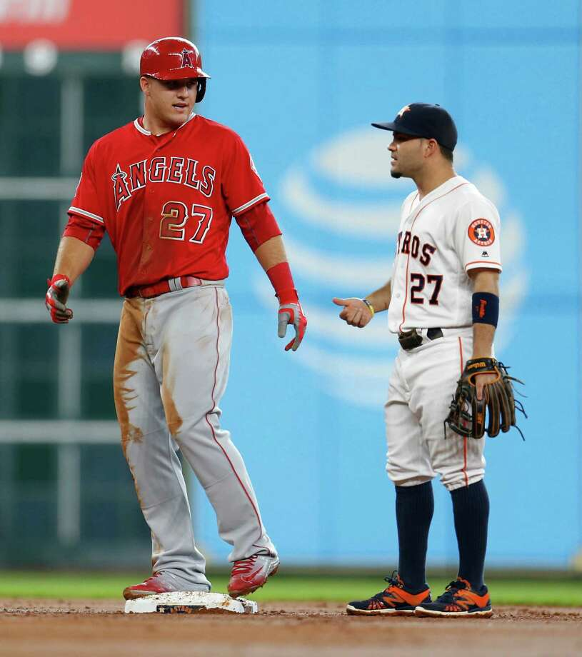 The Angels' Mike Trout (left) is looking up at the Astros' Jose Altuve on the consecutive games played list. Photo: Karen Warren, Houston Chronicle / © 2016 Houston Chronicle