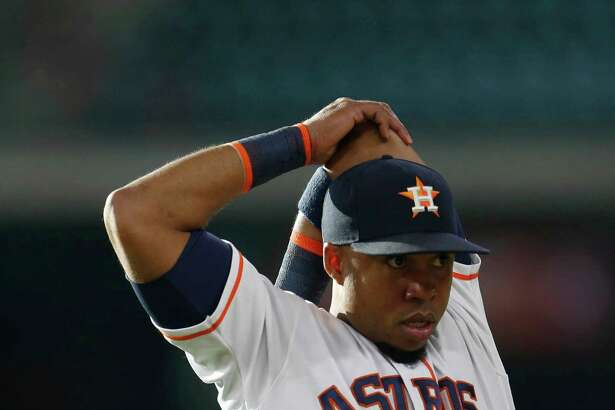 Houston Astros third baseman Luis Valbuena (18) stretches before the start of an MLB baseball game at Minute Maid Park, Tuesday, June 21, 2016, in Houston.