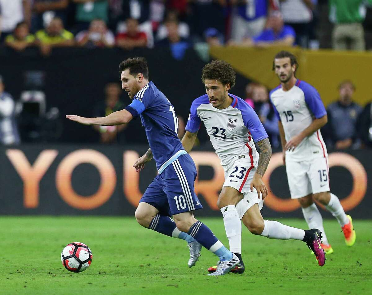 Argentina midfielder Lionel Messi (10) drives the ball downfield against United States defender Fabian Johnson (23) during the first half of a COPA America semi-final game at NRG Stadium, Tuesday, June 21, 2016, in Houston.