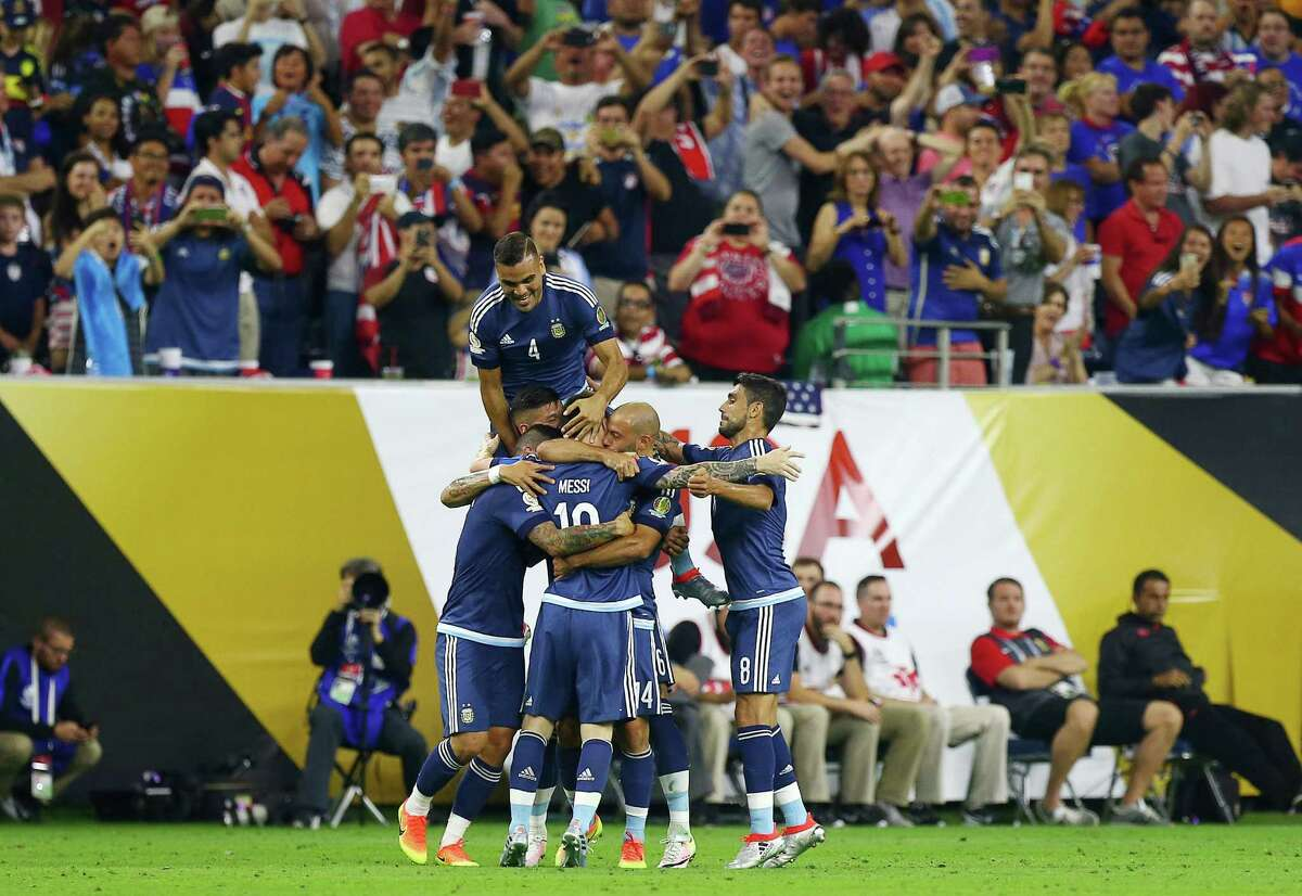 Argentina celebrates after Argentina midfielder Lionel Messi (10) scored a goal during the first half of a COPA America semi-final game at NRG Stadium, Tuesday, June 21, 2016, in Houston.