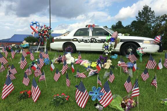The memorial for Patton Village police Sgt. Stacey Baumgartner grows at the community center just off U.S. 59.