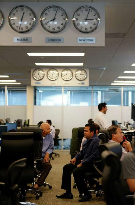 Amit Bhandari, CEO of BioUrja Trading, right, talks with a trader. BioUrja Trading focuses on energy, a major part of Houston's commerce with Europe. Photo: Karen Warren, Staff / © 2016 Houston Chronicle