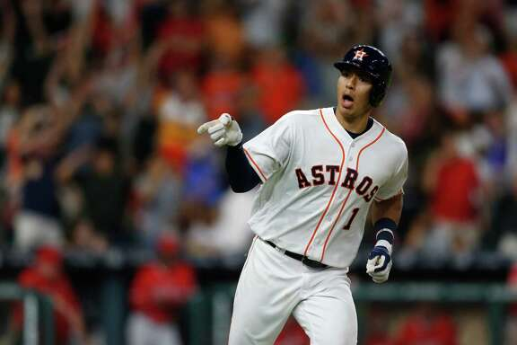 Houston Astros shortstop Carlos Correa (1) reacts after hitting a two-run walk off single  to win the game during the ninth inning of an MLB baseball game at Minute Maid Park, Tuesday, June 21, 2016, in Houston.