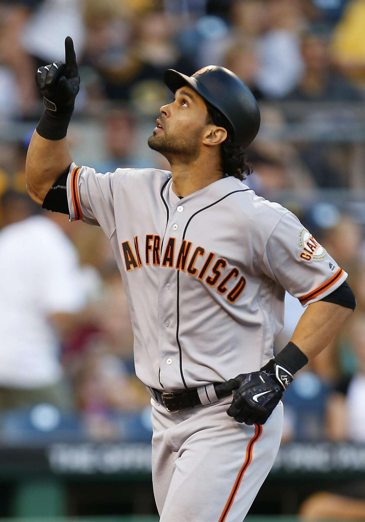 PITTSBURGH, PA - JUNE 21: Angel Pagan #16 of the San Francisco Giants reacts after hitting a grand slam home run in the fourth inning during the game against the Pittsburgh Pirates at PNC Park on June 21, 2016 in Pittsburgh, Pennsylvania. (Photo by Justin K. Aller/Getty Images)