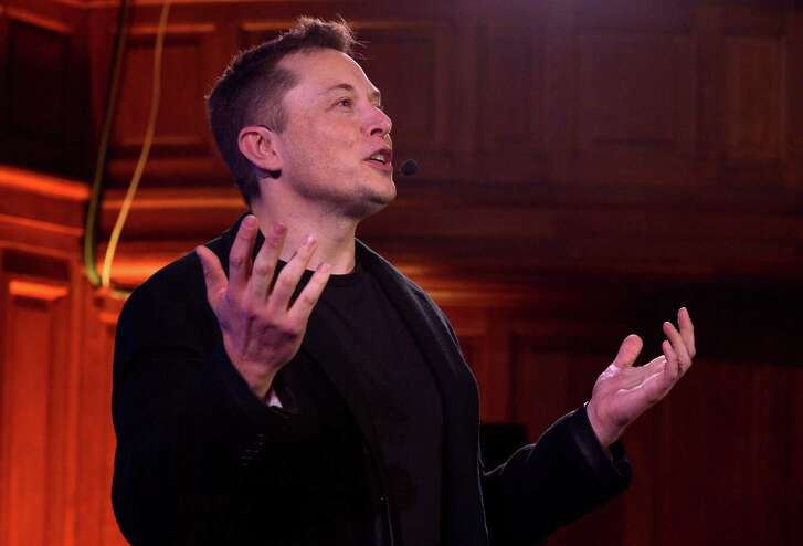 Elon Musk, CEO of US automotive and energy storage company Tesla, presents his outlook on climate change at the Paris-Sorbonne University in Paris on December 2, 2015. / AFP / ERIC PIERMONTERIC PIERMONT/AFP/Getty Images