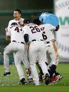 Shortstop Carlos Correa, rear, receives a celebratory water-cooler bath from his teammates after hitting a two-run, walkoff single to propel the Astros to a 3-2 win over the Angels on Tuesday at Minute Maid Park.