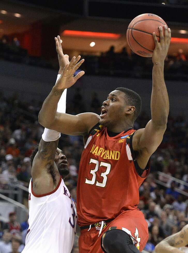 Maryland center Diamond Stone (33) shoots over Kansas forward Jamari Traylor during the second half of an NCAA college basketball game in the regional semifinals of the men's NCAA Tournament, in Louisville, Ky., Thursday, March 24, 2016. Kansas won 79-63. (AP Photo/Timothy D. Easley)