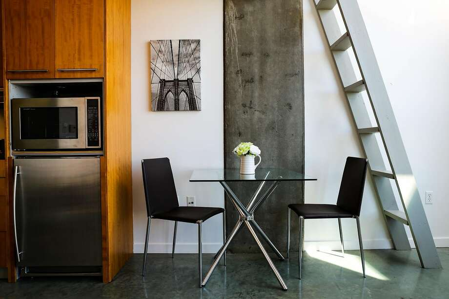 The dining area can be seen, of unit 813, which is an apartment that is currently on the market in the Cubix building, in San Francisco, California, on Sunday, June 19, 2016. Photo: Gabrielle Lurie, Special To The Chronicle