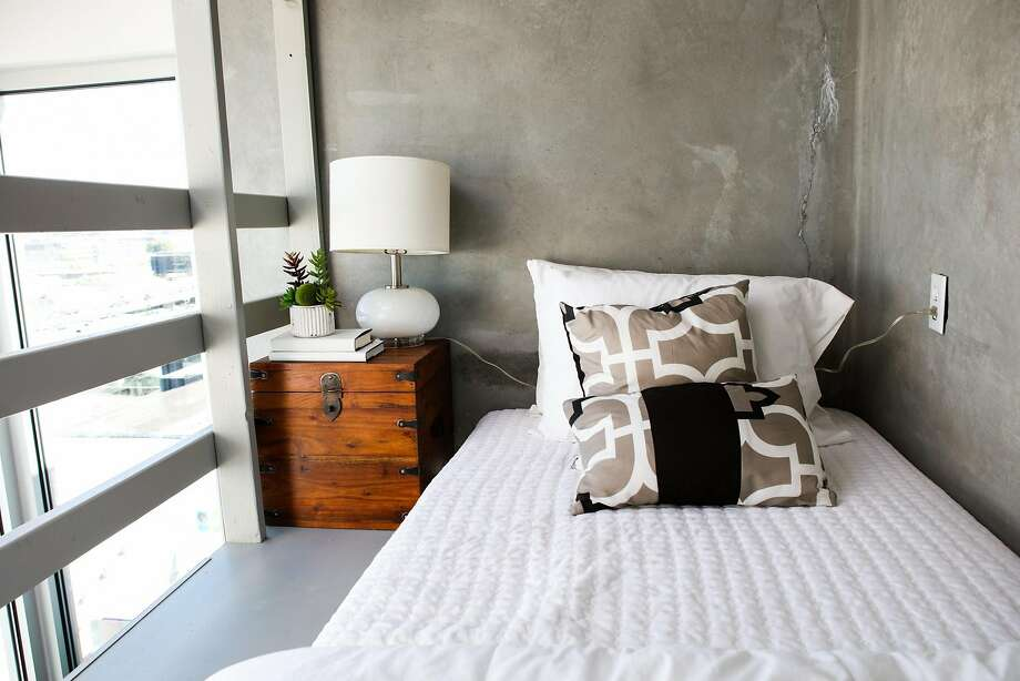 The lofted bedroom is one of the crucial touches in a tiny apartment in the Cubix building, of the nation's oldest tiny-home communities. Photo: Gabrielle Lurie, Special To The Chronicle