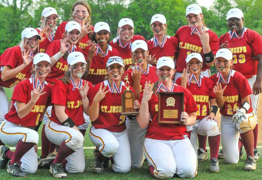 The St. Joseph Cadets celebrate winning the FCIAC Softball Championship game against the Stamford Black Knights at Sacred Heart University on May 26, 2016 in Fairfield, Connecticut. Photo: Gregory Vasil