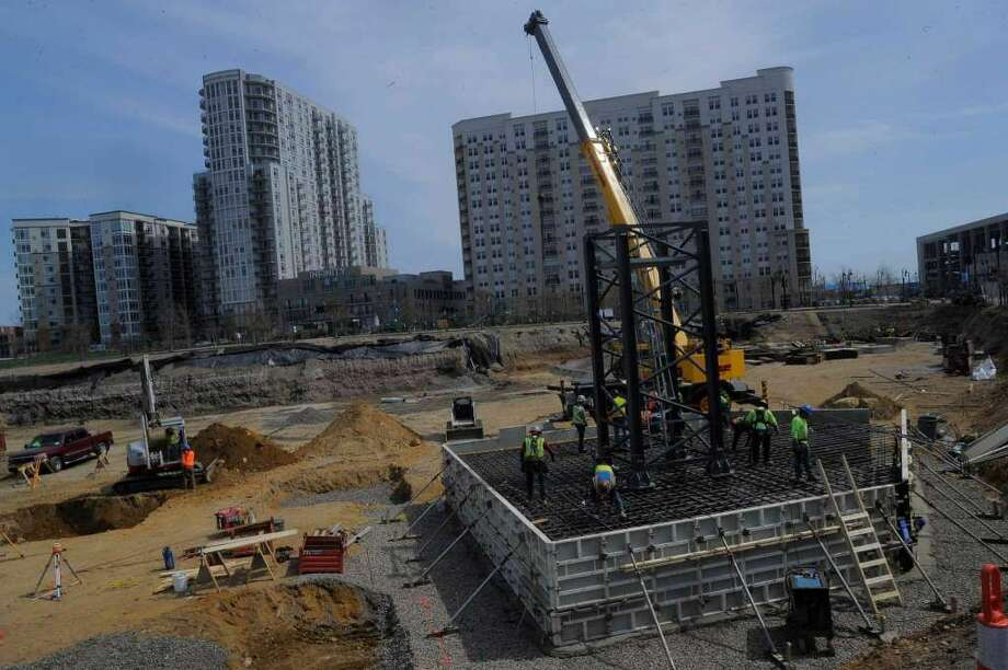 Neighbors are complaining of noise happening too early from construction, shown in April near the corner of Washington Avenue and Atlantic Street in Stamford's Harbor Point neighborhood. (Photo: Matthew Brown)