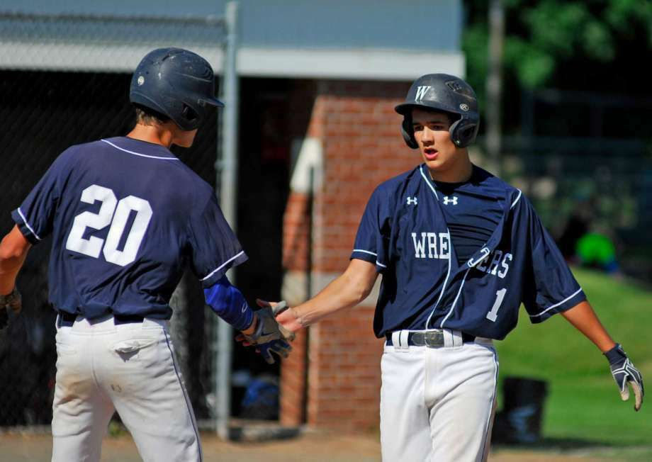 Staples' Elliott Poulley, right, greets a teammate during a Class LL first round baseball game against Ridgefield on Tuesday, May 31st, 2016. Photo: Ryan Lacey
