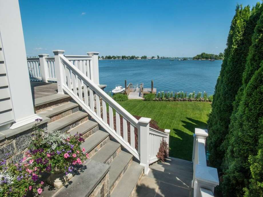 114 Cedar Cliff Rd, Riverside, CT 06878; 4 beds 4 baths 4,326 sqft. Features: Private dock, pool, garden extending to the waterfront