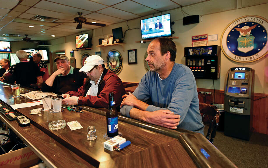 Patrons drink and share stories at the VFW Post 399 Tuesday, May 24, 2016, in Westport , Conn. Local VFW halls are having difficulty recruiting young veterans to become members. Photo: Erik Trautmann