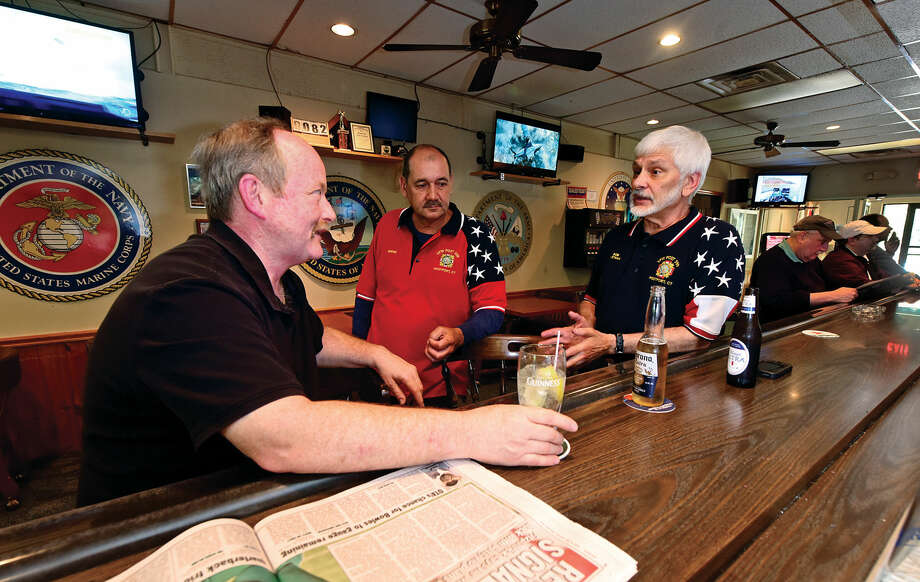 Patrons, including Joe Galla and Viet Nam veterans Bernie Rombout and Bob Tirreno, drink and share stories at the VFW Post 399 Tuesday, May 24, 2016, in Westport , Conn. Local VFW halls are having difficulty recruiting young veterans to become members. Photo: Erik Trautmann