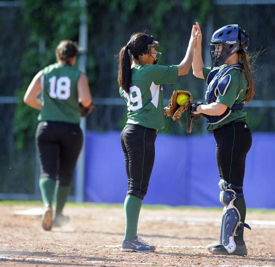 Norwalk pitcher Brianny Garcia confers with catcher Sam Troetti following an out in the third inning against Westhill in the first round of a CIAC Class LL softball game at Westhill High School in Stamford on May 31, 2016. Westhill defeated Norwalk 14-1, advancing to a second round game against Fairfield Ludlowe on Wednesday. Photo: Matthew Brown/Hearst Media Connecticut