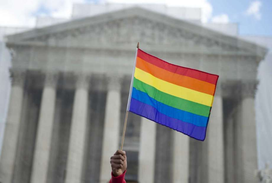 A same-sex marriage supporter waves a rainbow flag in front of the US Supreme Court on March 26, 2013 in Washington, DC, as the Court takes up the issue of gay marriage. A recent study showed that more Americans are engaging in same-sex encounters than before. (Photo: Saul Loeb, Staff)