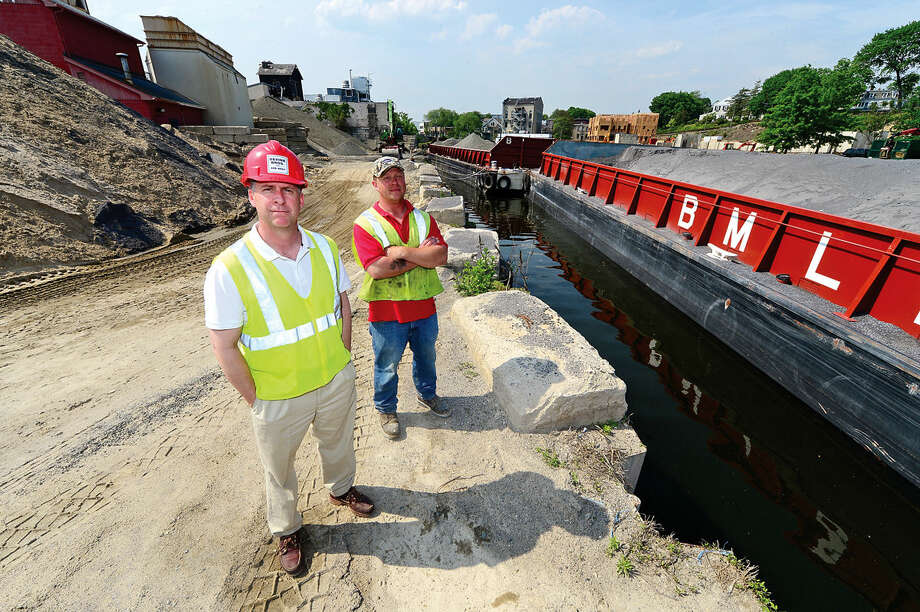 Devine Co. president, Tom Devine, comments their concerns with the Walk Bridge replacement project by Connecticut Department of Transportation (ConnDOT) Thursday, May 26, 2016 at their Norwalk, Conn. facility on the Norwalk River. Bob Kunkel, a marine engineer/ship builder based in Norwalk, is among a number of local residents urging the ConnDOT to weld shut rather than replace the Walk Bridge. He has also proposed a low-profile tugboat to haul barges under the existing bridge. Photo: Erik Trautmann