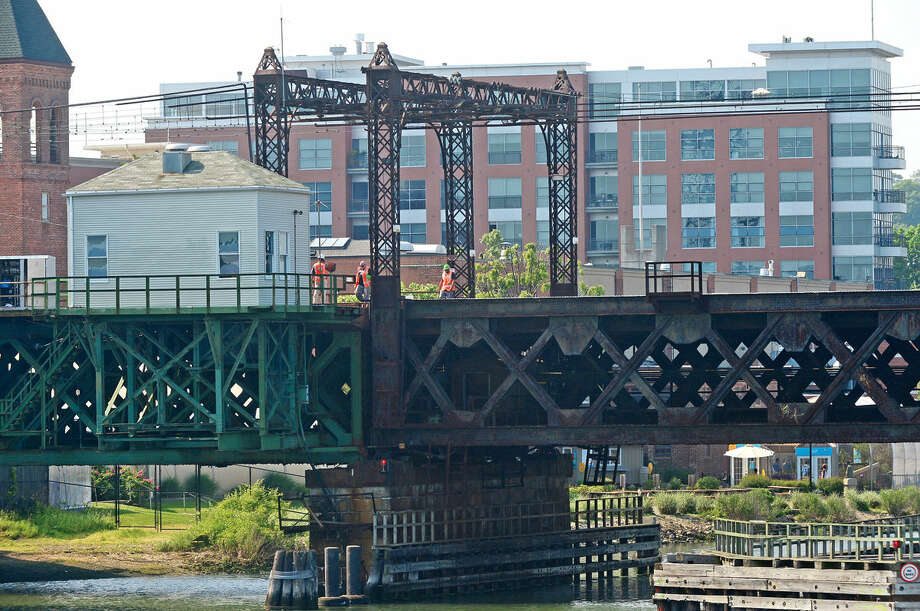 Metro-North workers examine the Walk Bridge in Norwalk, Conn. which became stuck in the open position Saturday, May 28, 2016, causing extreme travel delays. Photo: Erik Trautmann