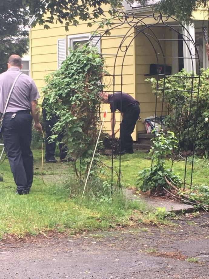 Milford firefighters assist injured vet with yard work Monday. (Photo: Lauren Abelli Via Facebook)