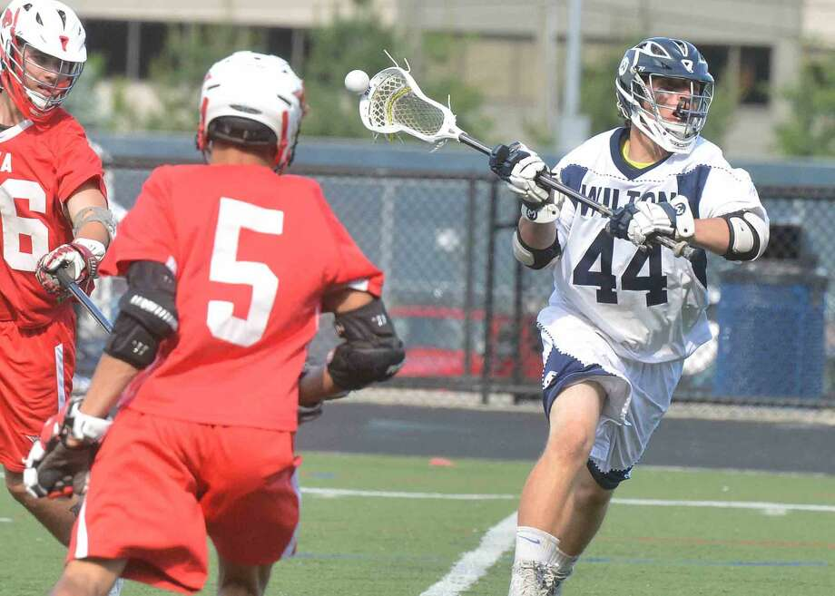 Wiltons #44 James Arbisi shoots and scores during the Class L game against Norwich Free Academy on Wednesday June 1 in Wilton Conn. Photo: Alex Von Kleydorff