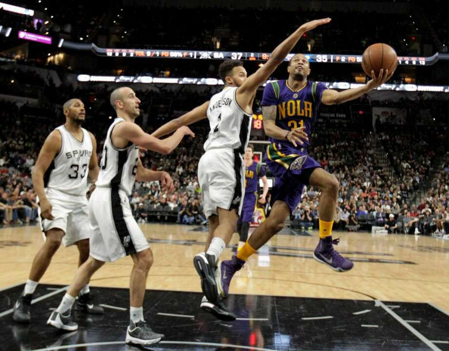 New Orleans Pelicans' Bryce Dejean-Jones gets through San Antonio Spurs' Boris Diaw, Manu Ginobili and Kyle Anderson during the second half at the AT&T Center, Wednesday, Feb. 3, 2016.