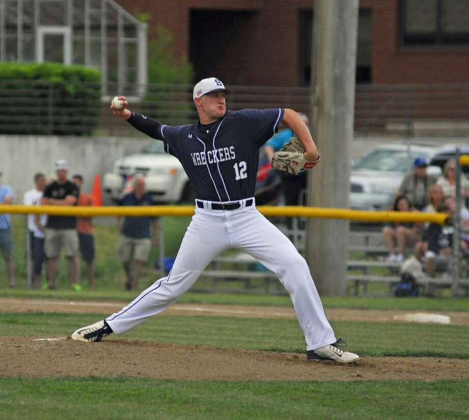 Staples' Ryan Fitton throws a pitch during a Class LL second round game at Southington Wednesday. Photo: Ryan Lacey