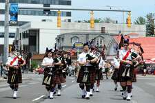 Bagpipers from the Mount Kisco Scottish Pipes and Drums walk down Summer Street as part of the Stamford Memorial Day Parade on Sunday, May 29, 2016.