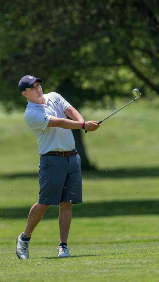 Staples High School's Dan Cozzi hits his ball on the fairway of the first hole at the FCIAC boys golf championship played at Fairchild Wheeler Golf Course, Fairfield, CT on Thursday, June 2, 2016. Photo: Mark Conrad