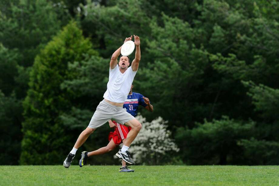 Nick Markovich drops the disc in the end zone during a pick-up ultimate frisbee game at Wakeman Park in Westport, Conn. on Sunday, May 15, 2016. Photo: Michael Cummo