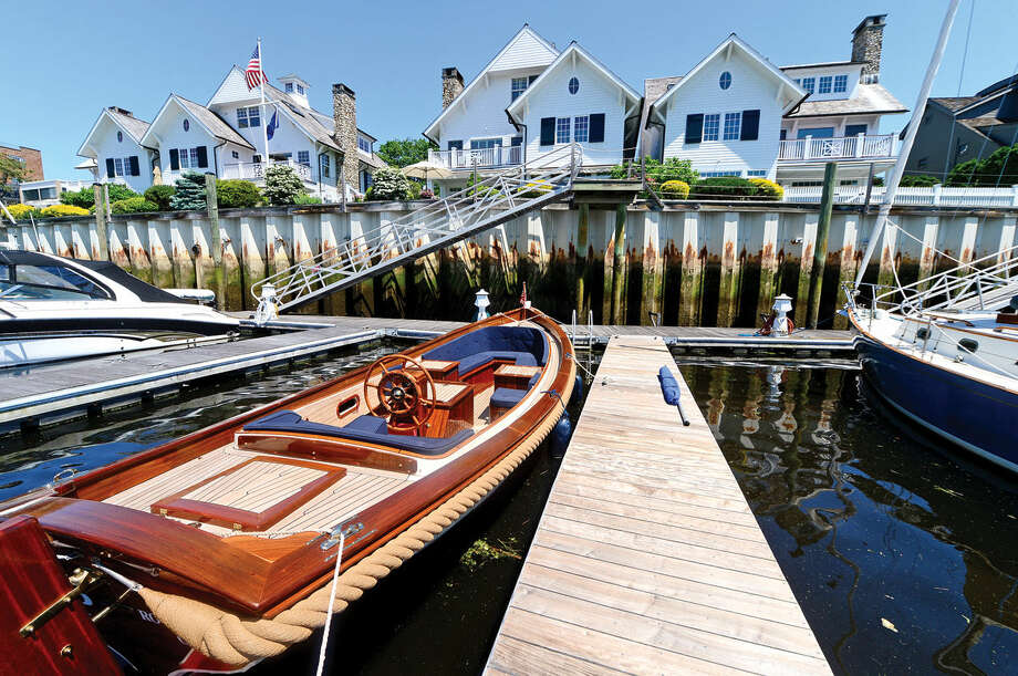 The home of Eva Landegger on the Five Mile River at 133 Rowayton Ave. on Tuesday, May 31, 2016, in Norwalk, Conn. is on the market for 4.995 million and includes a 27' wooden De Kapiteinssloep power boat. Photo: Erik Trautmann