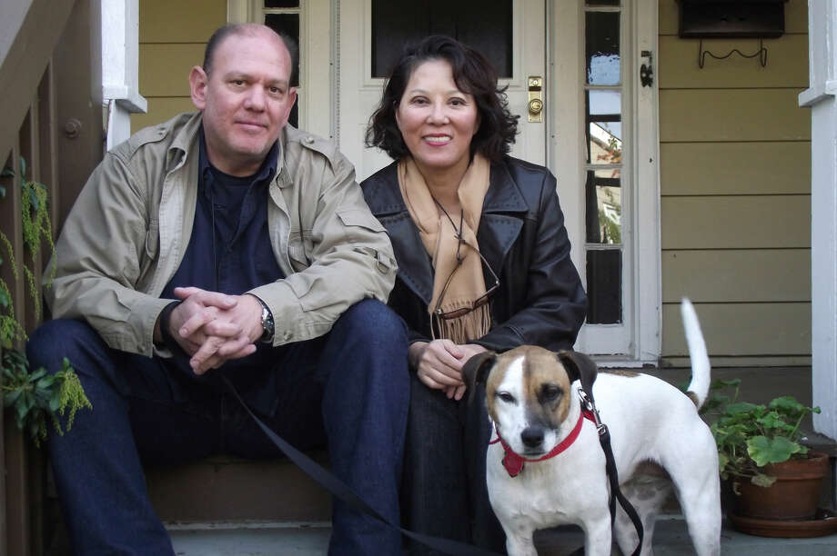 Red Parlor Records' Steven Goff, his wife Yuko Tanaka, a banking executive, and their dog Memphis pictured (left-right) in front of their East Norwalk residence which is also home to Red Parlor Records. Photo: Margaret Doherty