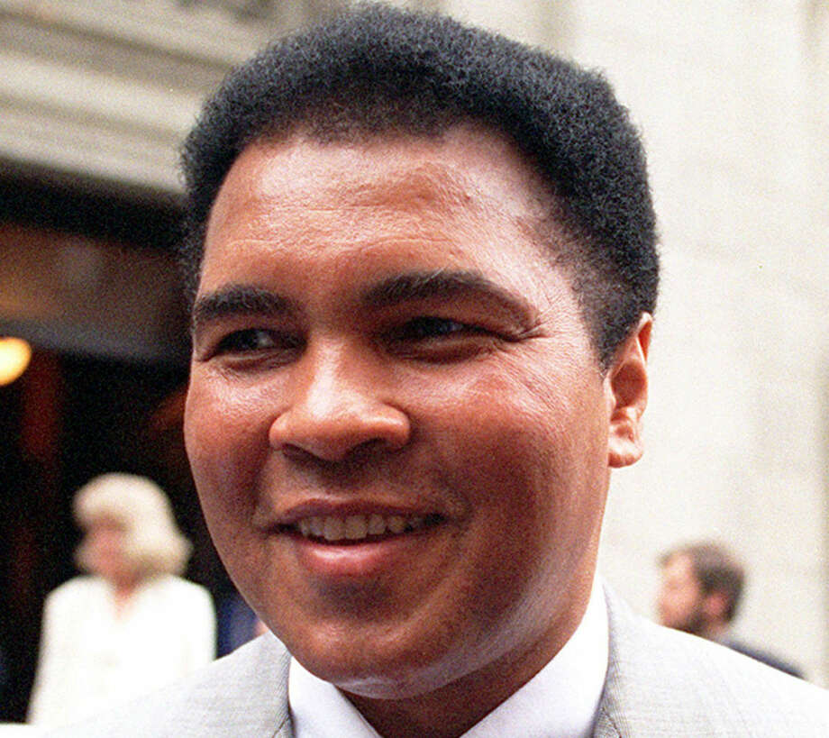 FILE - This is a 1995 file photo showing Muhammad Ali smiling during a visit to New York. Ali, the magnificent heavyweight champion whose fast fists and irrepressible personality transcended sports and captivated the world, has died according to a statement released by his family Friday, June 3, 2016. He was 74. (AP Photo/Mark Lennihan, FIle) Photo: MARK LENNIHAN