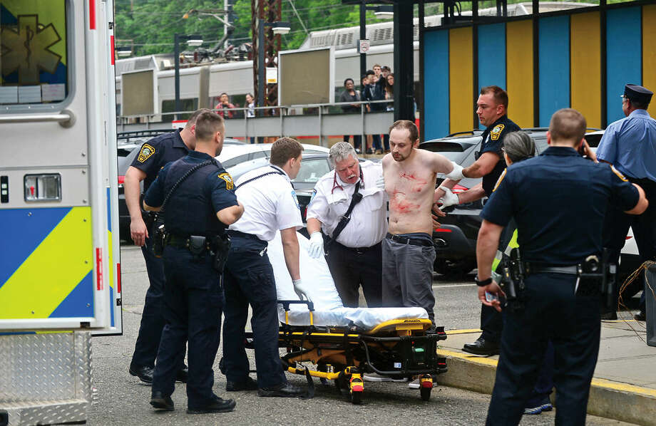 A knife-wielding passenger who was terrorizing fellow commuters on a southbound Metro-North train is arrested by Norwalk and Metro-North police at Rowayton Train Station in Norwalk, Conn. and transported to Norwalk Hopsital by paramedics with self-inflicted knife wounds on Friday, June3, 2016. Photo: Erik Trautmann
