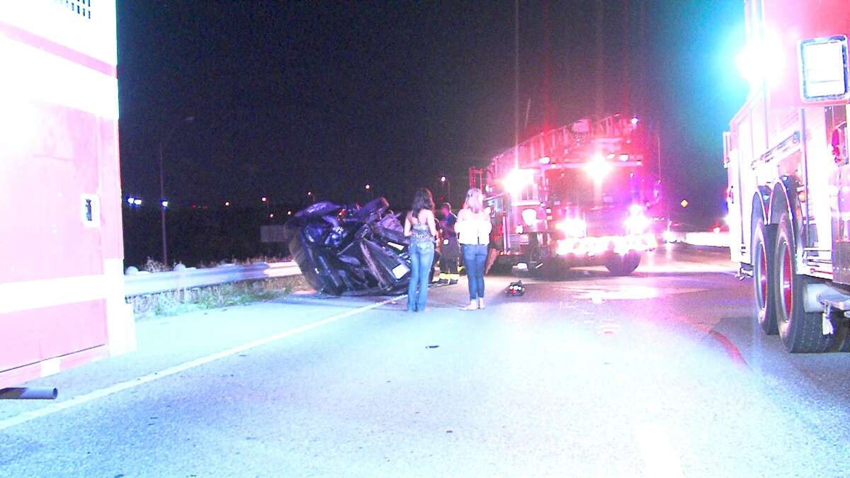 Firefighters cut a woman out of a vehicle following a crash on the North Side on Wednesday morning.