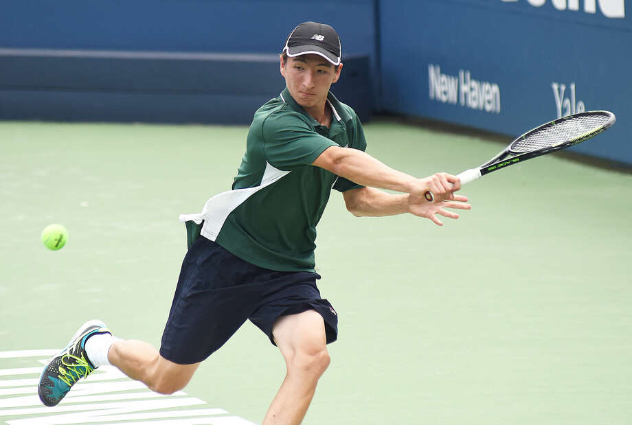Norwalk High's Seiji Hosokawa tracks down the ball for a return during his State Open singles tennis championship match against Will Andrews of Staples on Wednesday at the Connecticut Tennis Center's Stadium Court in New Haven. Hosokawa won the title with a 7-6 (7-3), 6-3 victory. Photo: John Nash