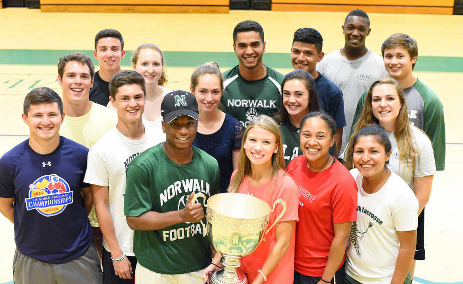 A group of Norwalk High School athletic captains and senior leaders pose for a photo with The Hour Cup after clinching the championship for the third straight school year. The Hour Cup is awarded to the winner of the annual battle between Norwalk's varsity sports team and those at Brien McMahon. The Bears won the Cup with a 10-7-3 advantage over the 2015-16 school year. Photo: John Nash