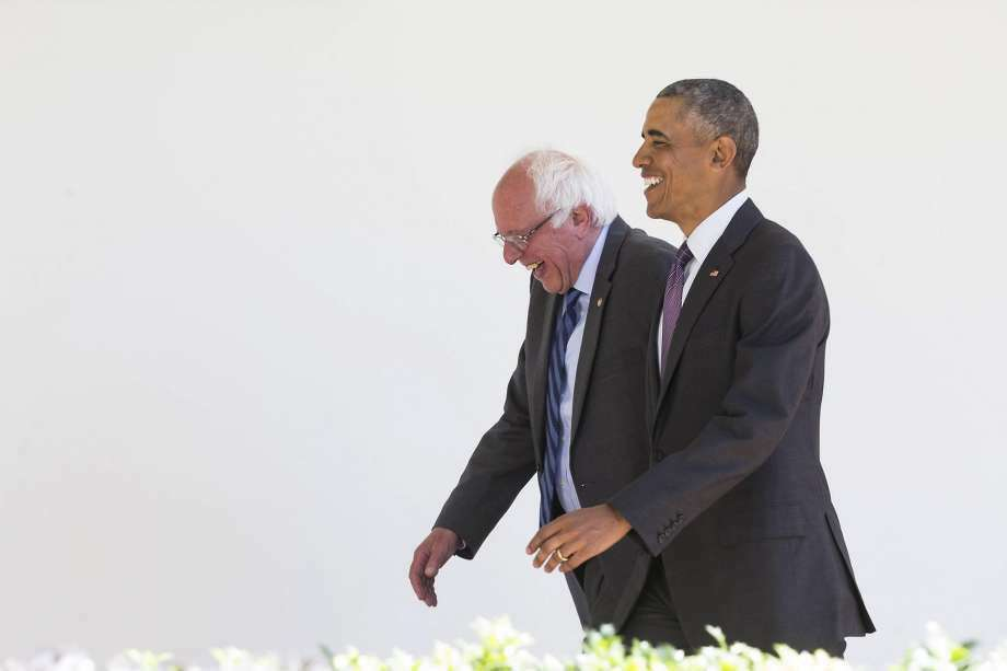 President Barack Obama and Sen. Bernie Sanders of Vermont, a Democratic presidential hopeful, walk to the Oval Office for a meeting, at the White House in Washington, June 9, 2016. The president is trying to negotiate with Sanders about exiting the race for the Democratic nomination without damaging efforts to unite the party. (Zach Gibson/The New York Times)
