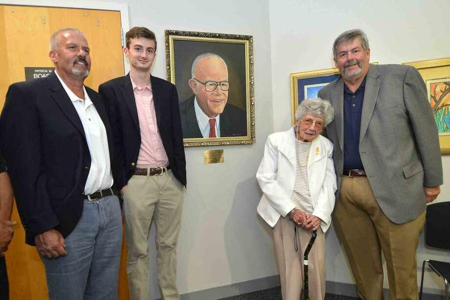 The Briggs family surrounds the portrait, just unveiled of former Norwalk Superintendent of Schools, Richard Briggs. L-R Lyndon Briggs, R.J. Briggs, Madelyn Briggs and Allyn Briggs at Norwalk City hall on Wednesday June 8, 2016 in Norwalk Conn. Photo: Alex Von Kleydorff