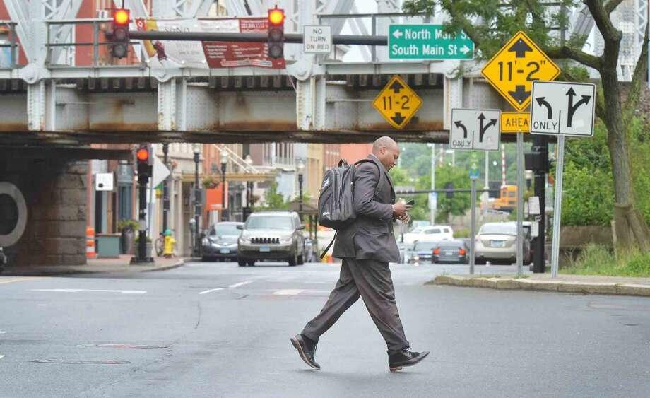 A pedestrian crosses Washington St. towards Madison St. in South Norwalk on Wednesday June 8, 2016 in Norwalk Conn. Photo: Alex Von Kleydorff