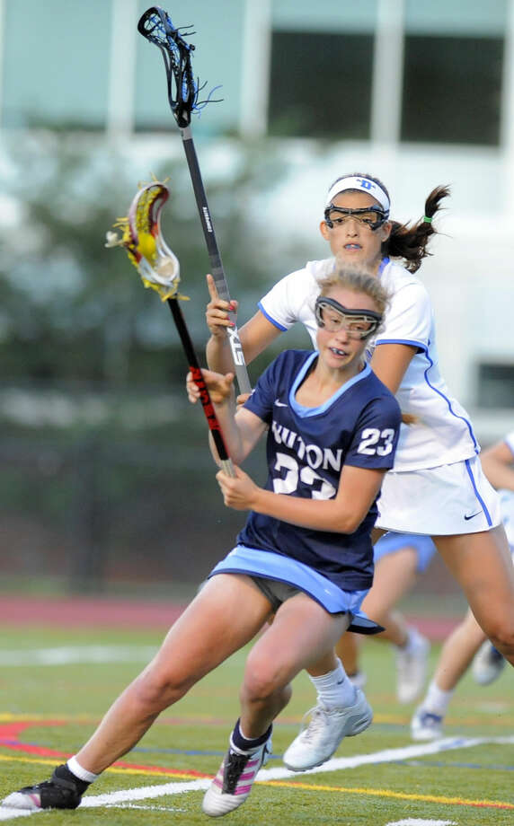 Wilton Paisley England looks for an opening while being defended by Darien Emma Lasko in a CIAC Class L girls lacrosse semifinal game at Taft Field in Fairfield, Conn. on June 7, 2016. Darien won 8-6. Photo: Matthew Brown