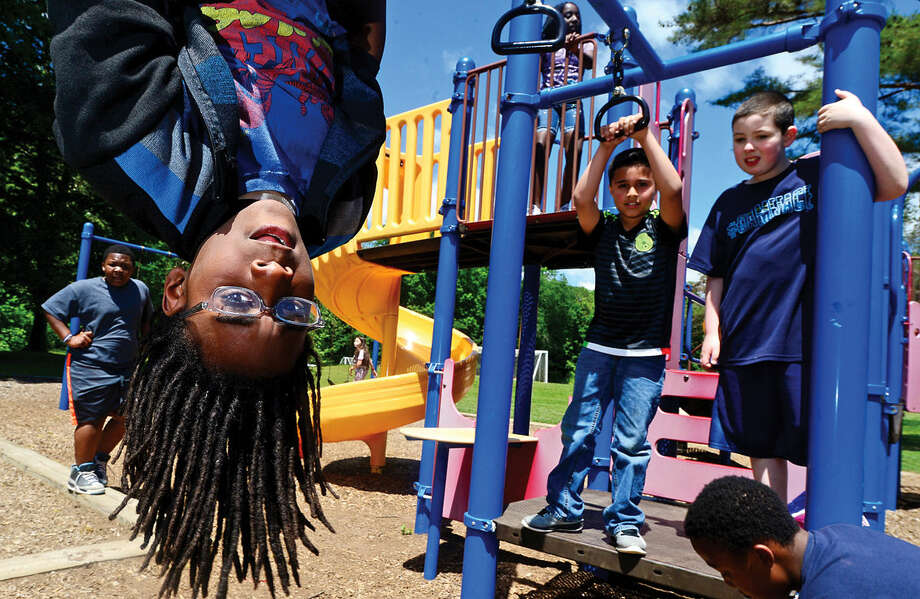 4th graders at Silvermine Elementary School in Norwalk, Conn., including Joshua Brim, enjoy recess on the playground Thursday, June 9, 2016. A new Norwalk Public Schools wellness policy may expand recess time in the school day. Photo: Erik Trautmann